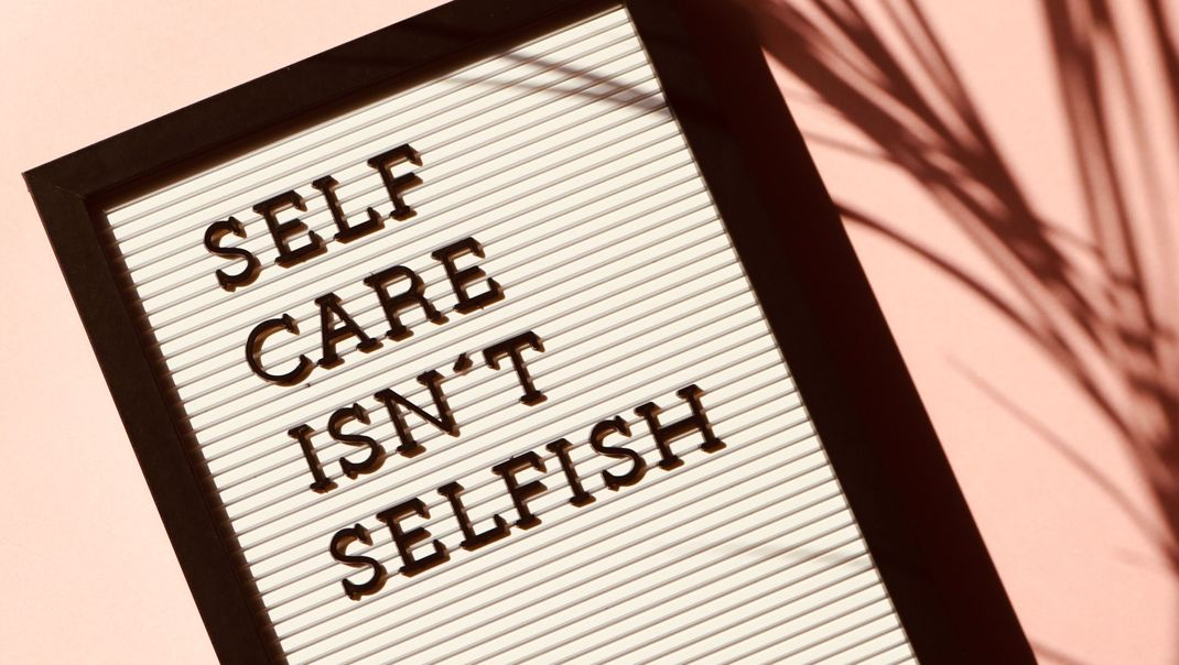 Sign that reads self-care isn't selfish